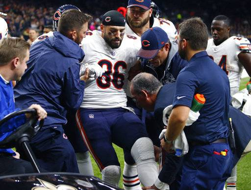 Chicago Bears tight end Zach Miller (86) is placed on a cart after injuring his leg in the second half of an NFL football game against the New Orleans Saints in New Orleans, Sunday, Oct. 29, 2017. Miller hurt his leg on an apparent touchdown reception that was overturned on review. (AP Photo/Butch Dill)