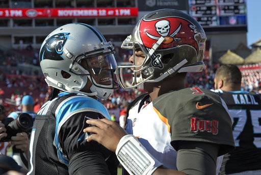 Tampa Bay Buccaneers quarterback Jameis Winston, right, congratulates Carolina Panthers quarterback Cam Newton after the Panthers defeated the Buccaneers 17-3 during an NFL football game Sunday, Oct. 29, 2017, in Tampa, Fla. (AP Photo/Phelan M. Ebenhack)