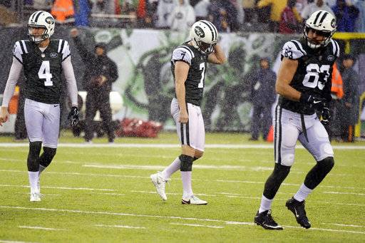 As rain falls, New York Jets kicker Chandler Catanzaro (7) reacts after missing a field goal during the second half of an NFL football game against the Atlanta Falcons, Sunday, Oct. 29, 2017, in East Rutherford, N.J. (AP Photo/Bill Kostroun)