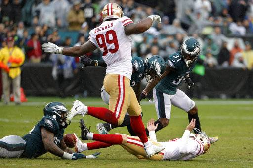 Philadelphia Eagles' Malcolm Jenkins (27), Derek Barnett (96) and Jalen Mills (31) scramble along with San Francisco 49ers' DeForest Buckner (99) for a blocked field goal-attempt by Robbie Gould (9), bottom right, during an NFL football game, Sunday, Oct. 29, 2017, in Philadelphia. (AP Photo/Chris Szagola)