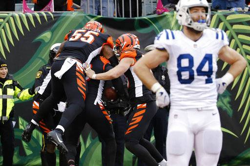Indianapolis Colts tight end Jack Doyle (84) reacts as Cincinnati Bengals defensive end Carlos Dunlap celebrates with teammates after scoring a touchdown on an interception in the second half of an NFL football game, Sunday, Oct. 29, 2017, in Cincinnati. (AP Photo/Frank Victores)