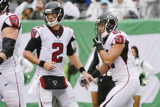 Atlanta Falcons quarterback Matt Ryan (2) celebrates with teammate Austin Hooper after they connected for a touchdown during the first half of an NFL football game against the New York Jets, Sunday, Oct. 29, 2017, in East Rutherford, N.J. (AP Photo/Seth Wenig)