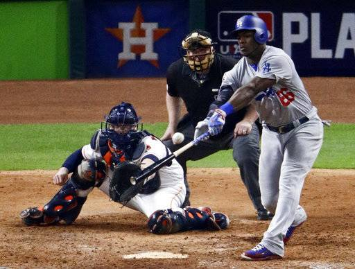 Los Angeles Dodgers' Yasiel Puig hits two-run home run against the Houston Astros during the ninth inning of Game 5 of baseball's World Series Sunday, Oct. 29, 2017, in Houston. (AP Photo/Charlie Riedel)