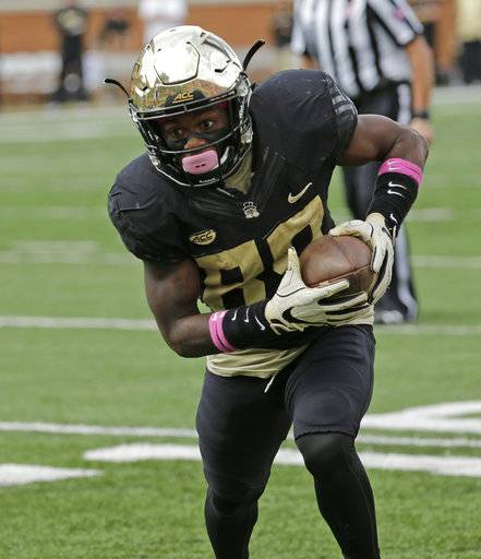 Wake Forest's Greg Dortch (89) runs for a touchdown after a catch against Louisville during the first half of an NCAA college football game in Winston-Salem, N.C., Saturday, Oct. 28, 2017. (AP Photo/Chuck Burton)