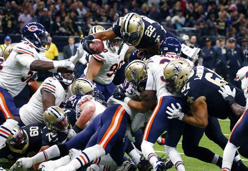 New Orleans Saints running back Mark Ingram (22) leaps for a touchdown in the first half of an NFL football game against the Chicago Bears in New Orleans, Sunday, Oct. 29, 2017. (AP Photo/Butch Dill)