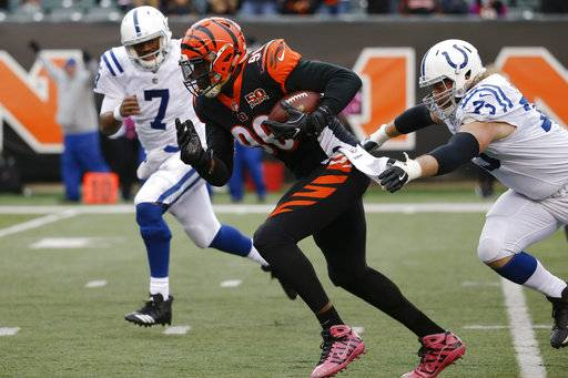 Cincinnati Bengals defensive end Carlos Dunlap (96) breaks away from Indianapolis Colts offensive tackle Joe Haeg, right, to score a touchdown on an interception in the second half of an NFL football game, Sunday, Oct. 29, 2017, in Cincinnati. (AP Photo/Frank Victores)