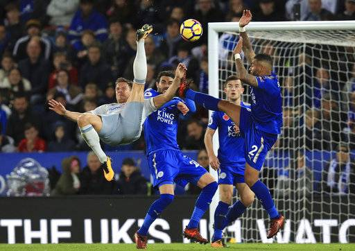 Everton's Phil Jagielka attempts an overhead kick during the match against Leicester City, during their English Premier League soccer match at the King Power Stadium in Leicester, England, Sunday Oct. 29, 2017. (Mike Egerton/PA via AP)