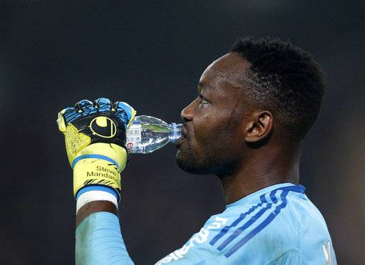 Marseille's goalkeeper Steve Mandanda drinks water during their French League one soccer match against Lille at the Lille Metropole stadium, in Villeneuve d'Ascq, northern France, Sunday, Oct. 29, 2017. (AP Photo/Michel Spingler)