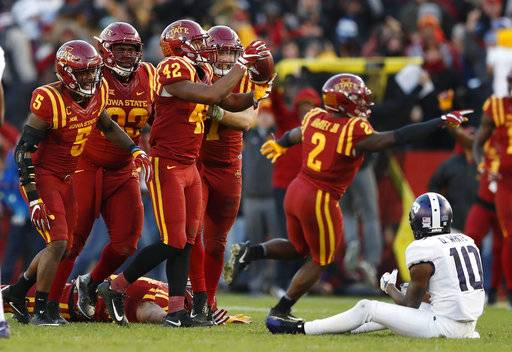 Iowa State linebacker Marcel Spears Jr. (42) celebrates with teammates after intercepting a pass in front of TCU wide receiver Desmon White (10) during the second half of an NCAA college football game, Saturday, Oct. 28, 2017, in Ames, Iowa. Iowa State won 14-7. (AP Photo/Charlie Neibergall)