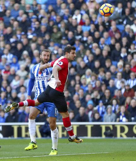 Brighton & Hove Albion's Glenn Murray, right, scores his side's first goal of the game during against Southampton during their English Premier League soccer match at the AMEX Stadium in Brighton, England, Sunday Oct. 29, 2017. (Gareth Fuller/PA via AP)