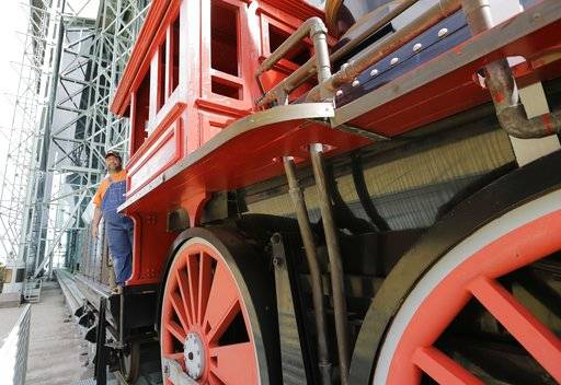 Bobby Vasquez operates a train in and around Minute Maid Park before Game 4 of baseball's World Series between the Houston Astros and the Los Angeles Dodgers Saturday, Oct. 28, 2017, in Houston. (AP Photo/Eric Gay)