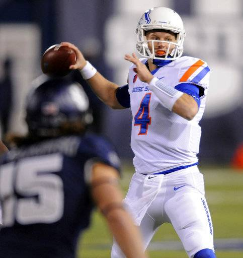 Boise State quarterback Brett Rypien (4) looks to throw the ball against Utah State during an NCAA college football game, Saturday, Oct. 28, 2017, in Logan, Utah. (Eli Lucero/Herald Journal via AP)/The Herald Journal via AP)