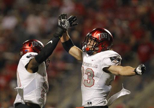 From left to right, UNLV's Chauncey Scissum and Dalton Baker celebrate a victory over Fresno State during the second half of an NCAA college football game that UNLV won 26-16 in Fresno, Calif., Saturday, Oct. 28 2017. (AP Photo/Gary Kazanjian)
