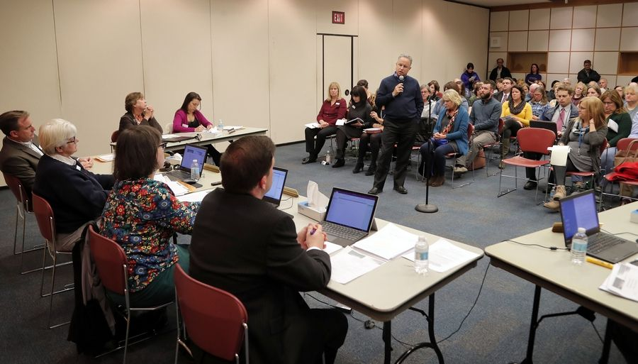 Former Arlington Heights Memorial Library Board President Jim Bertucci speaks Monday during public comment at a board meeting, in support of the current board leadership.