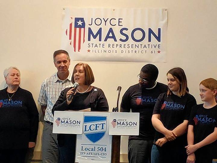 Woodland Elementary District 50 school board member Joyce Mason, center with microphone, has announced she'll run as a Democrat for norther Lake County's 61st District state House seat.