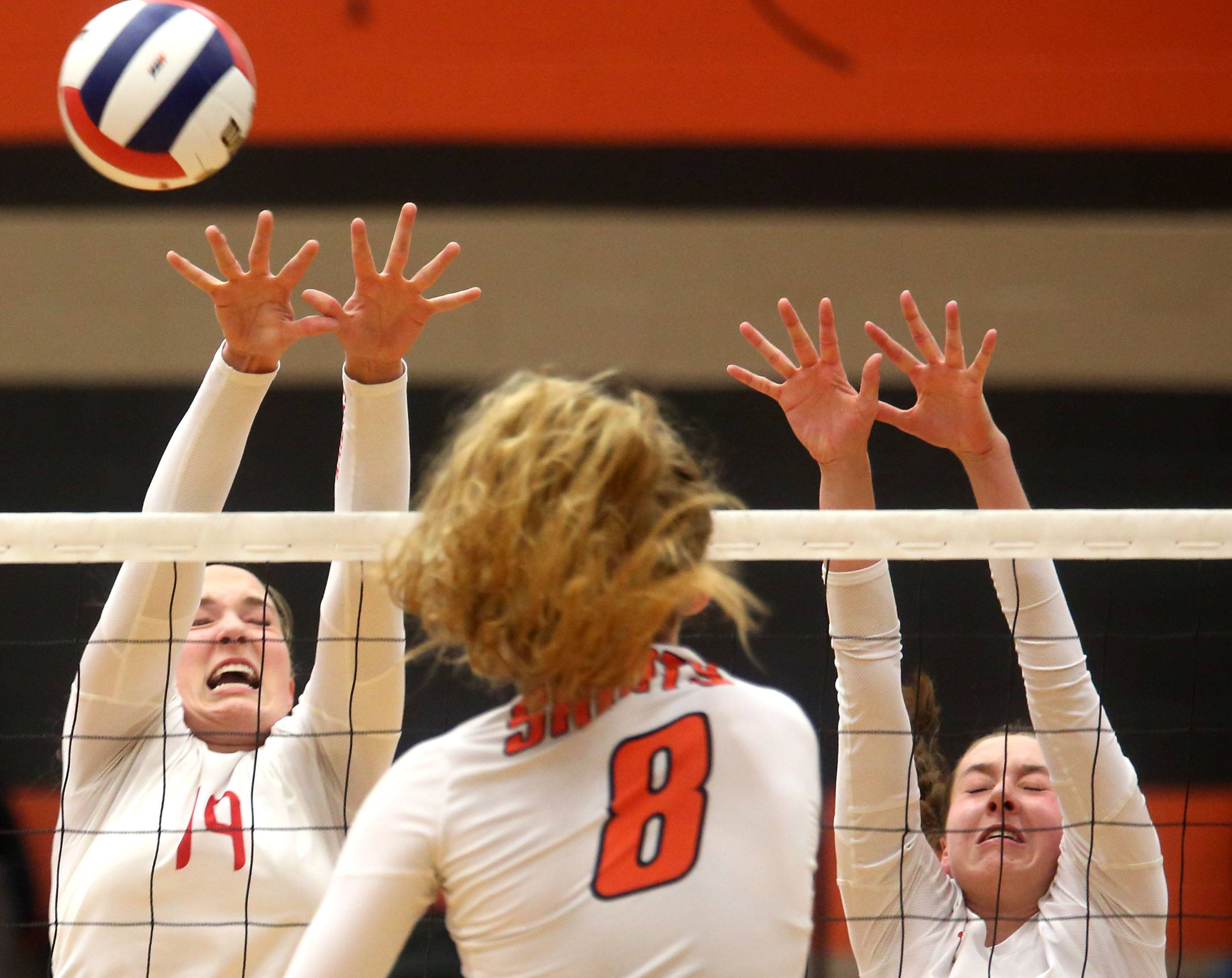 Huntley's Loren Alberts, left, and Emma Konie, block against St. Charles East's Kyra Slavik.