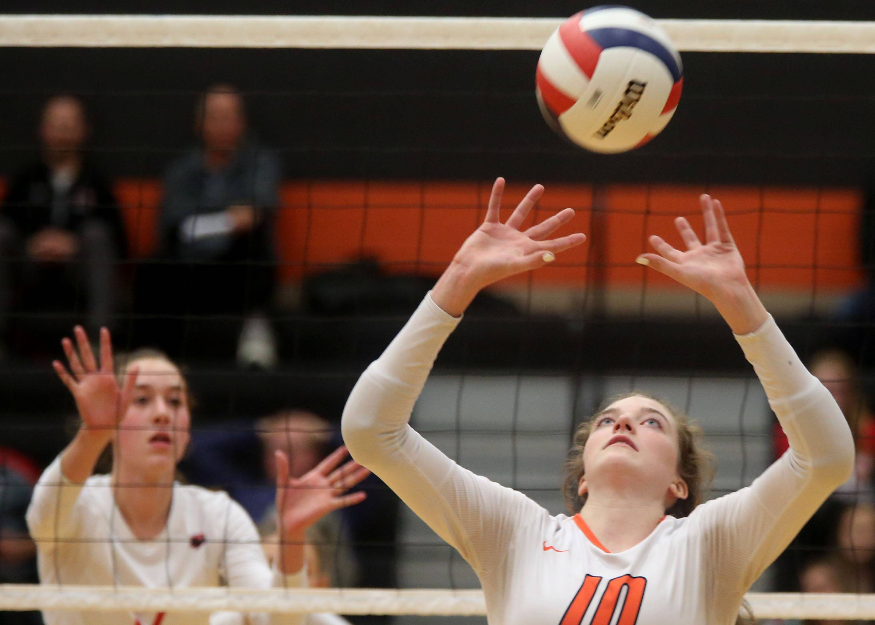 St. Charles East's McKenna Slavic moves the ball against Huntley during sectional semifinal varsity volleyball action at Chuck Dayton Gymnasium on the campus of DeKalb High School Monday night.