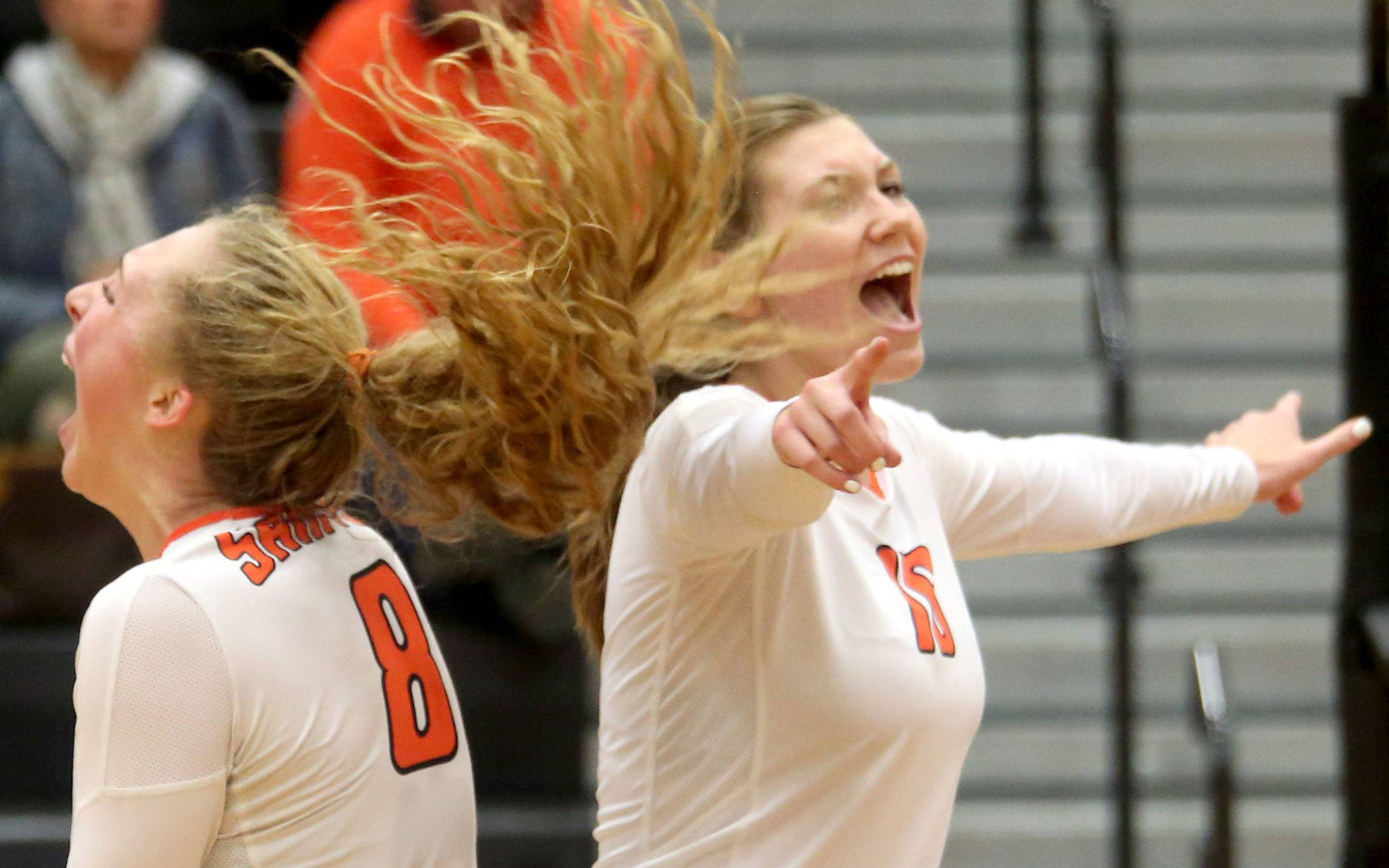 St. Charles East's Kyra Slavic, left, and Kirsten Rogers celebrate a win over Huntley at the Class 4A DeKalb sectional Monday.