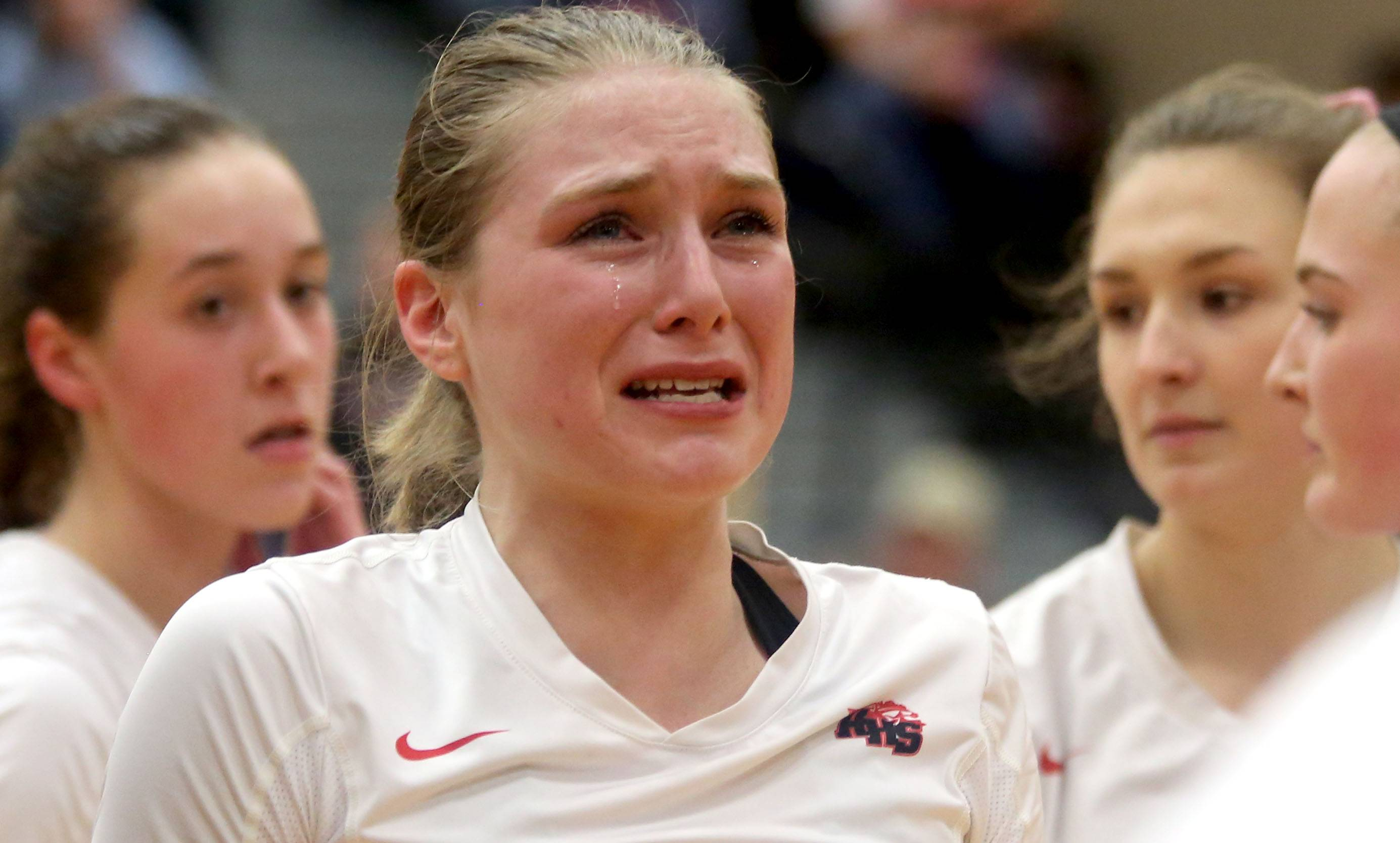 Huntley's Aleah Amelio reacts to a season-ending loss to St. Charles East during sectional semifinal varsity volleyball action at Chuck Dayton Gymnasium on the campus of DeKalb High School Monday night.