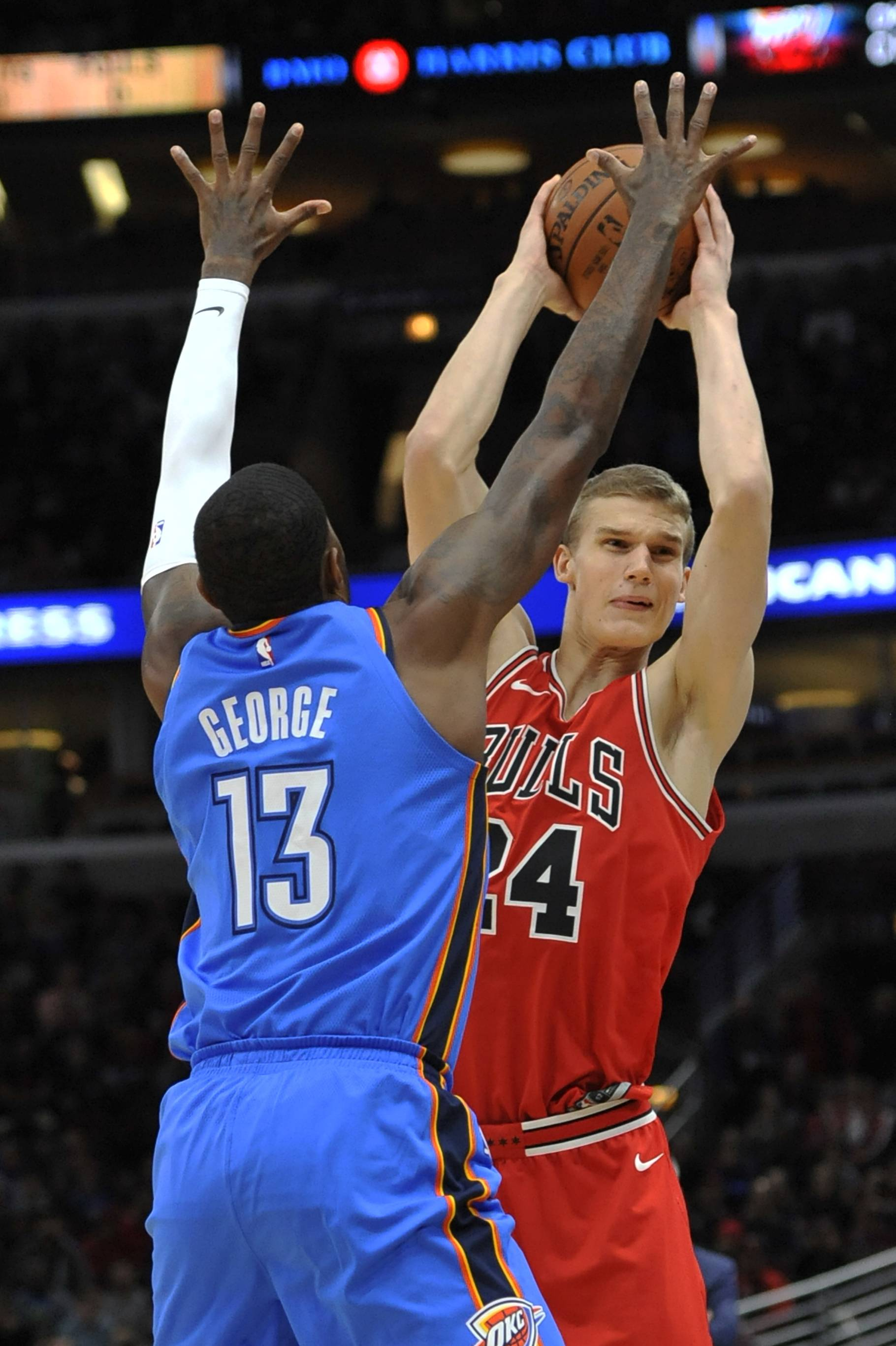 Chicago Bulls' Lauri Markkanen (24), of Finland, looks to pass against Oklahoma City Thunder's Paul George (13) during the second half of an NBA basketball game Saturday, Oct. 28, 2017, in Chicago.