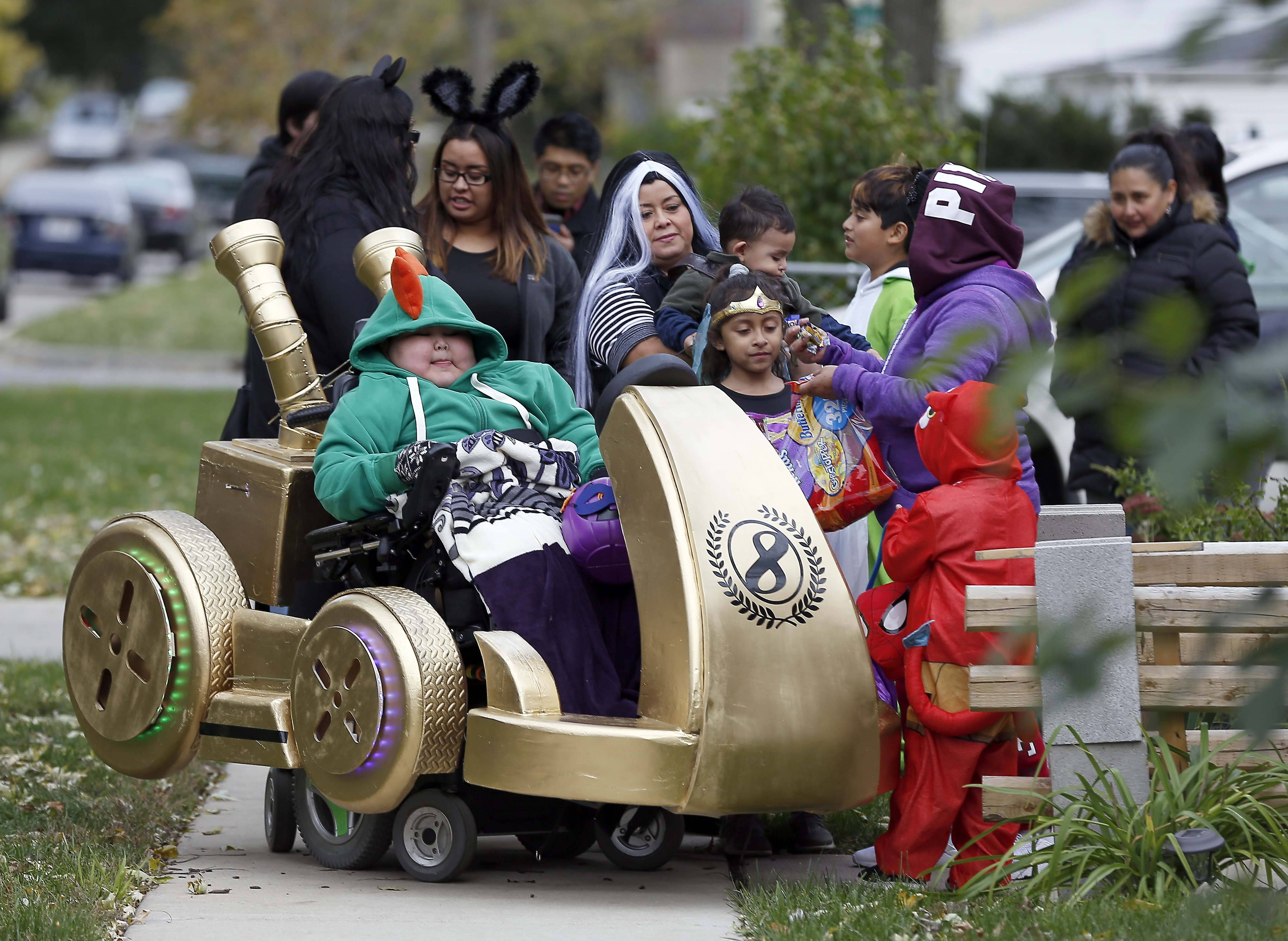 "Iker Lagunas, 12, of Elgin, goes trick-or-treating Tuesday in a costume that incorporates his wheelchair. The custom-made ""Mario Kart"" costume is modeled from his favorite video game."
