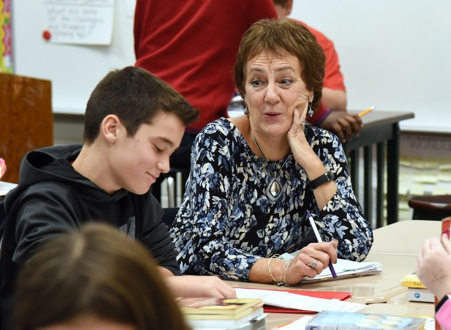 Big Hollow Elementary Middle School teacher Nancy Ward talks to sixth grader Rylan Art in English Language Arts class. The Ingleside school increased the number of students meeting or exceeding proficiency standards by 7.1 percentage points.