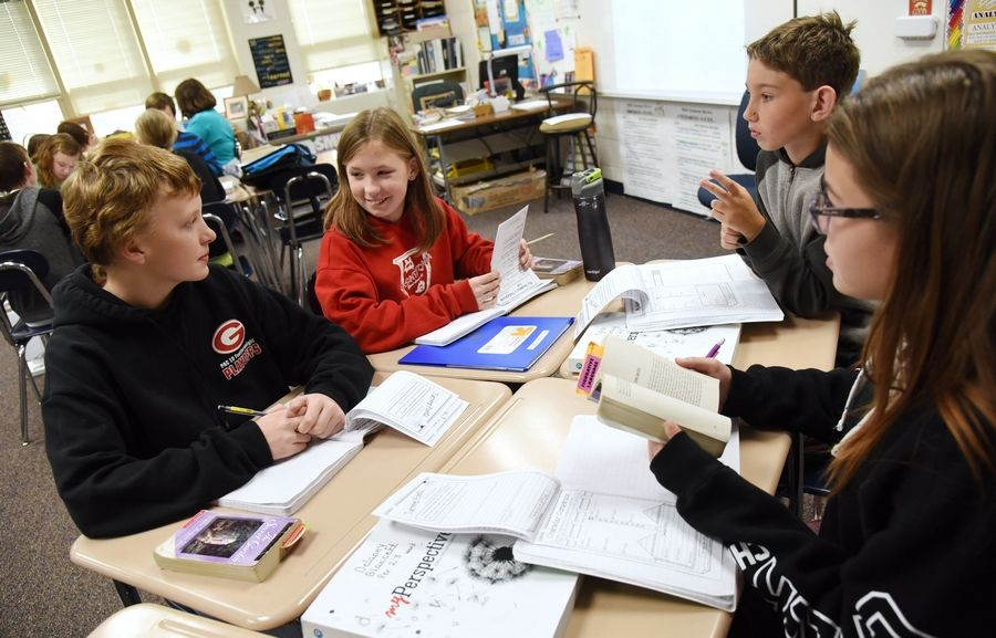 Big Hollow Middle School students from left, Matthew Bedrosian, Kylie Pongetti, Tyler Herzog and Delaney Blancett discuss novels in their study group.