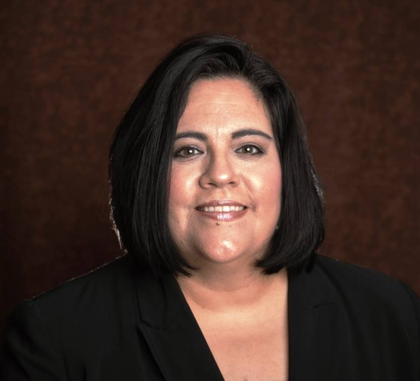 Veronica Noland, an Elgin Area School District U-46 board member, is a product of the district's Hispanic Parent Leadership Institute. The districts parent leadership institutes will receive an excellence award Wednesday from Reflejos Publications.