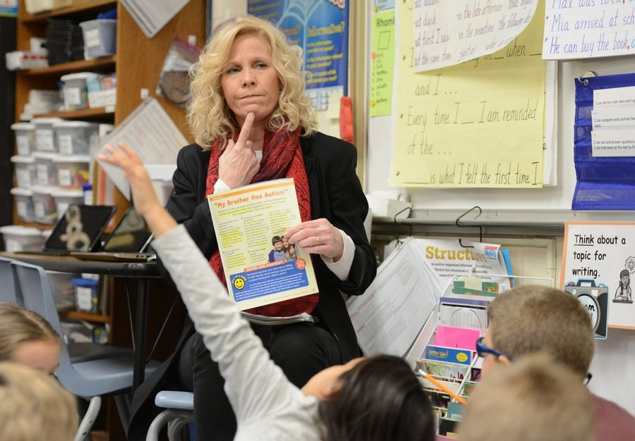 Third-grade English language arts teacher Kathy Hansen quizzes students Monday at Centennial Elementary School. The Bartlett school's students have shown consistent growth on the PARCC test.