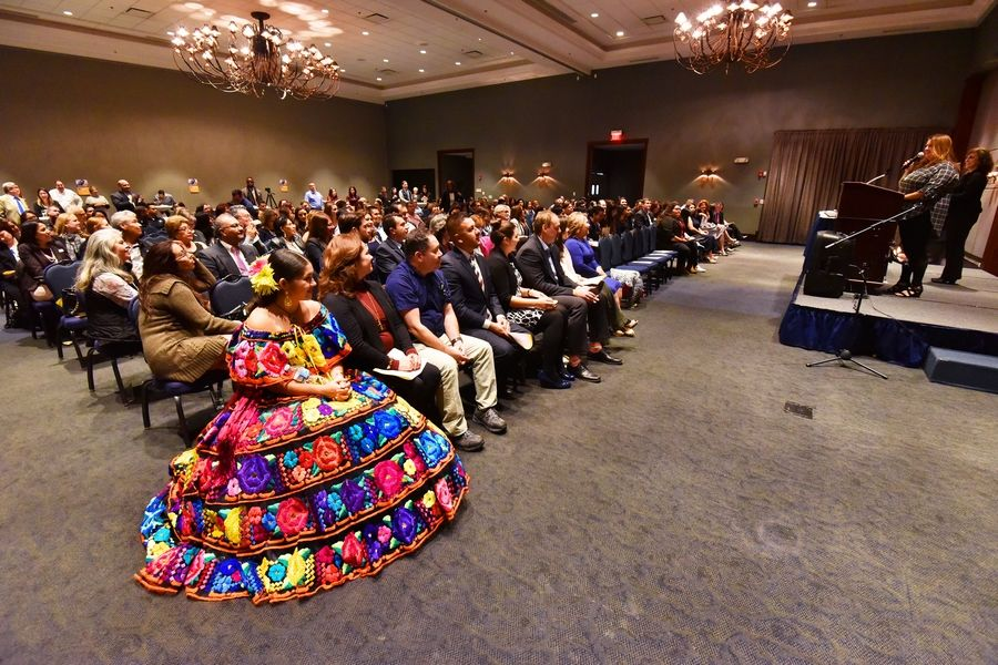 South Elgin High School junior Andrea Michel wears a colorful dress as she sits among the crowd Wednesday at Reflejos' Reflecting Excellence Awards in Hoffman Estates. Stonegate Conference and Banquet Centre in Hoffman Estates. She sang traditional Mexican songs at the event.