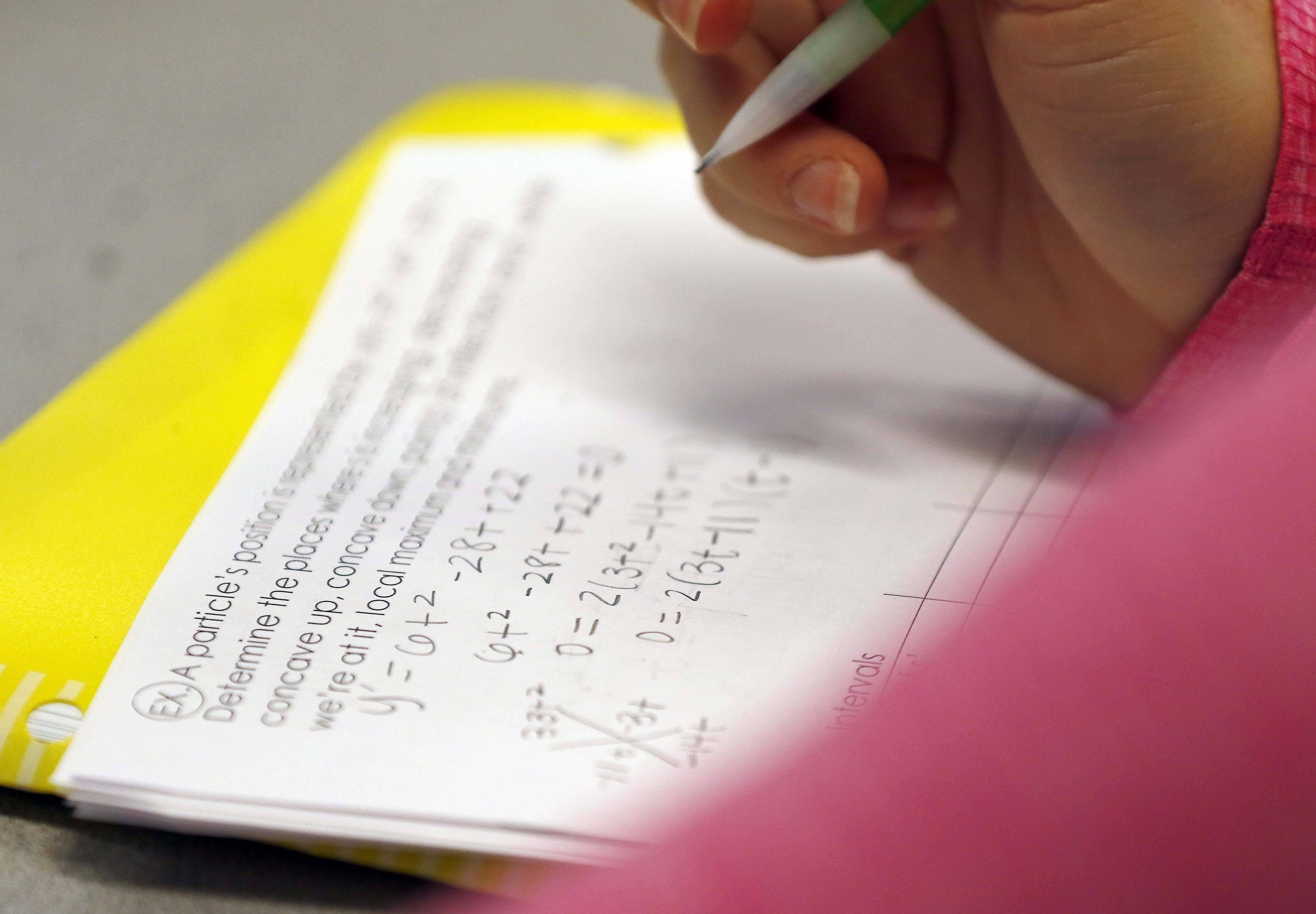 A student works on a math assignment during an AP Calculus class at St. Charles North High School.