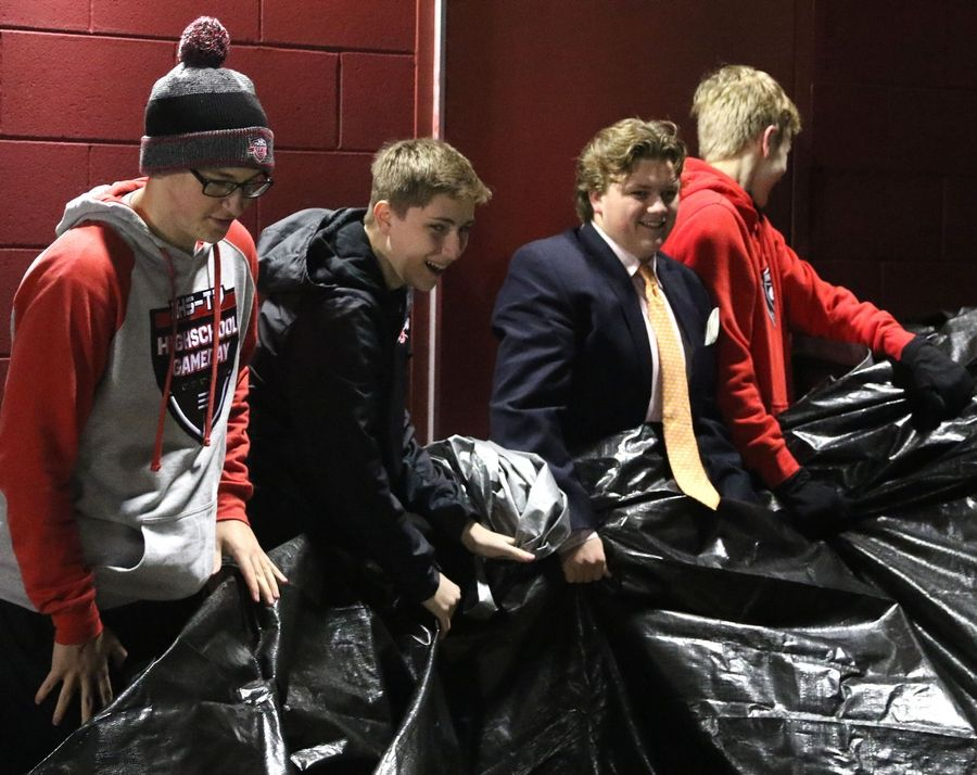 Barrington High School students last Friday removed a large black tarp as they unveil a donated van similar to professional live news trucks.