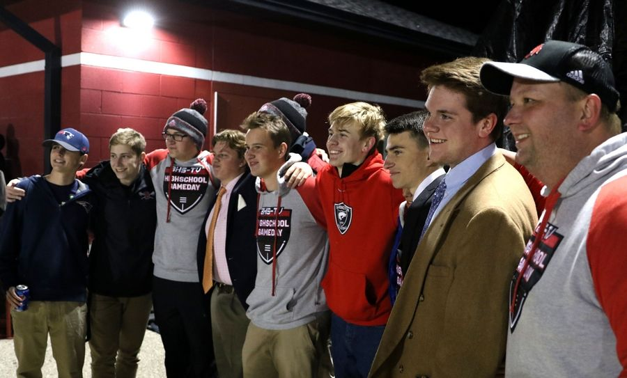 Barrington High School staff and students on Friday night pose for pictures after unveiling a donated, customized state-of-the-art van with television production equipment for live broadcasts.