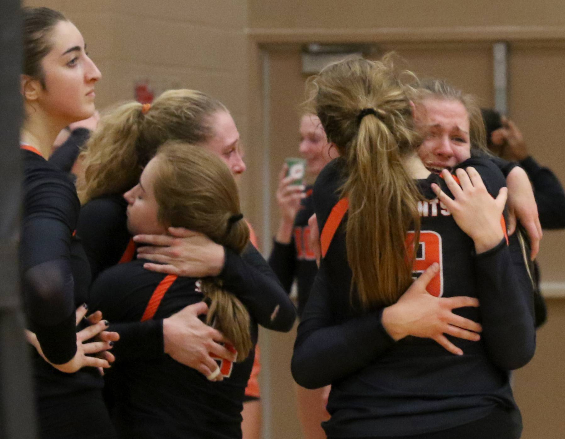 The Saints of St. Charles East react after a season-ending loss to crosstown rival St. Charles North during a Class 4A sectional title match at Chuck Dayton Gymnasium on the campus of DeKalb High School Wednesday night.