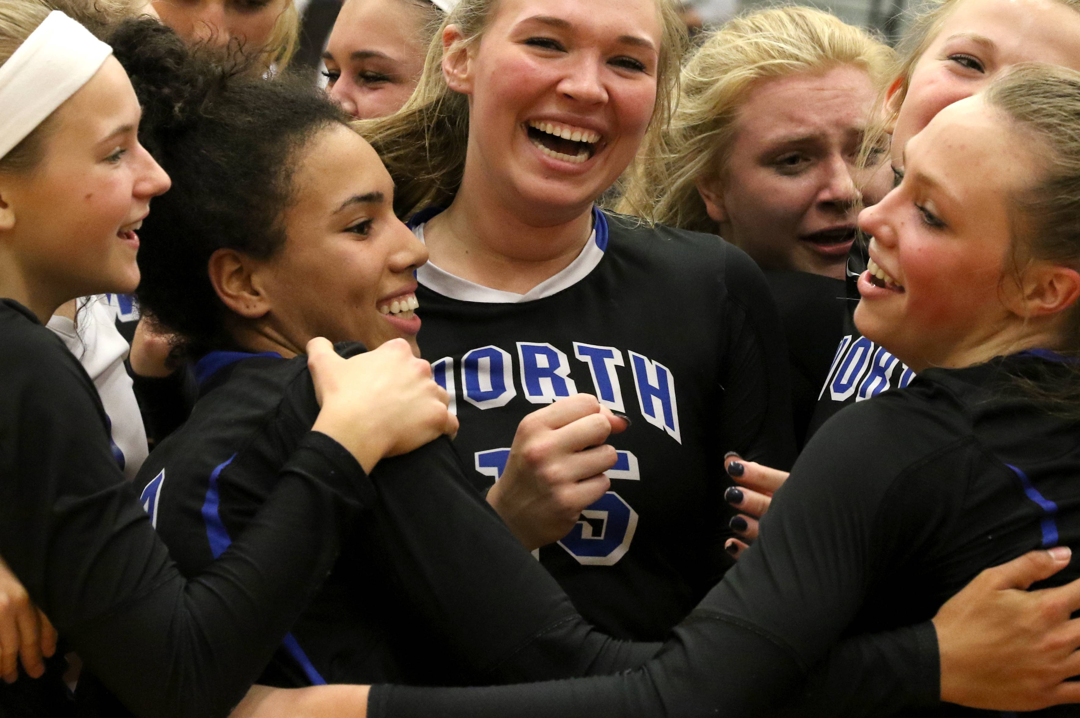 The St. Charles North Stars begin to celebrate a sectional title victory over St. Charles East at Chuck Dayton Gymnasium on the campus of DeKalb High School Wednesday night.