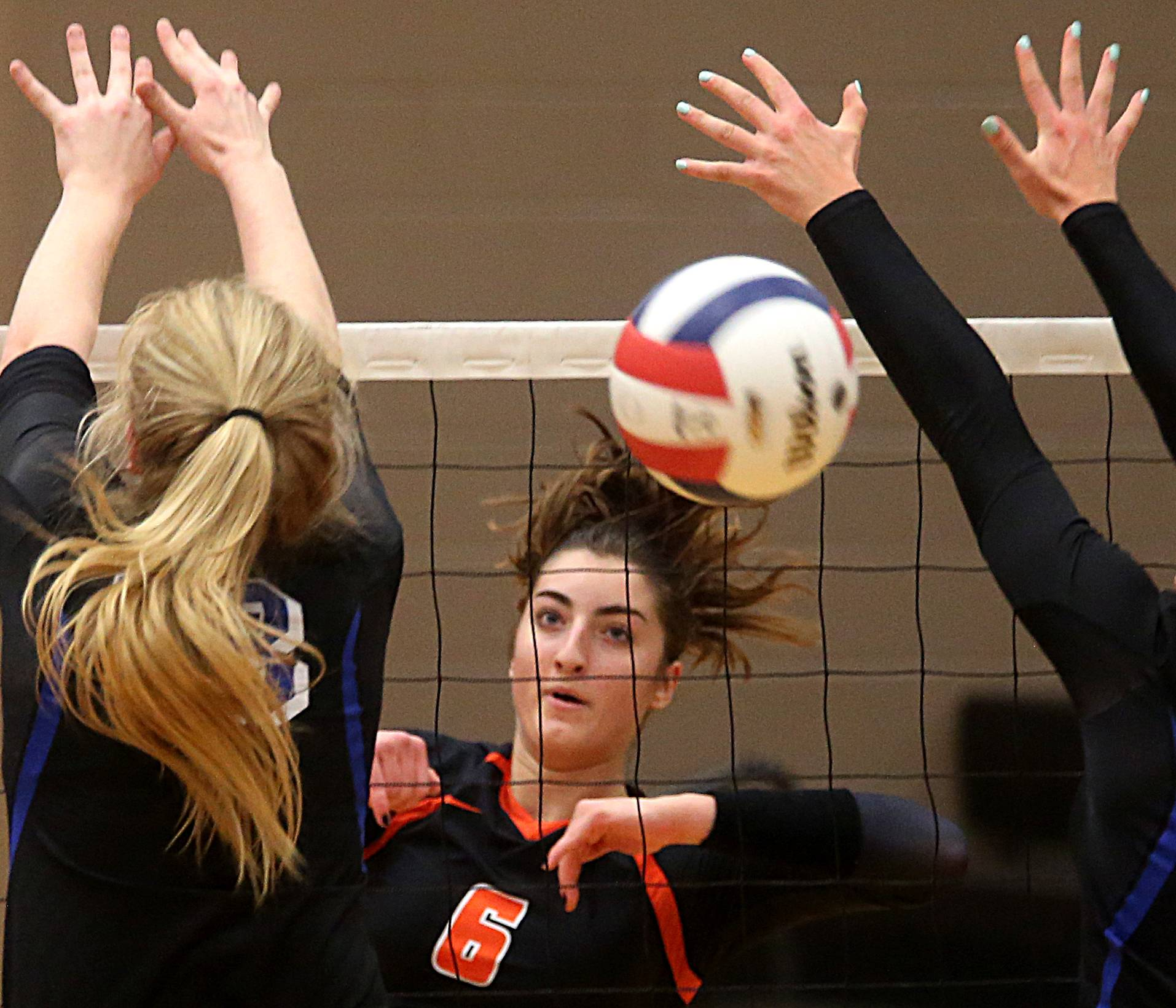 St. Charles East's Klaudia Sowizral completes a spike against St. Charles North during a Class 4A sectional title match at Chuck Dayton Gymnasium on the campus of DeKalb High School Wednesday night.