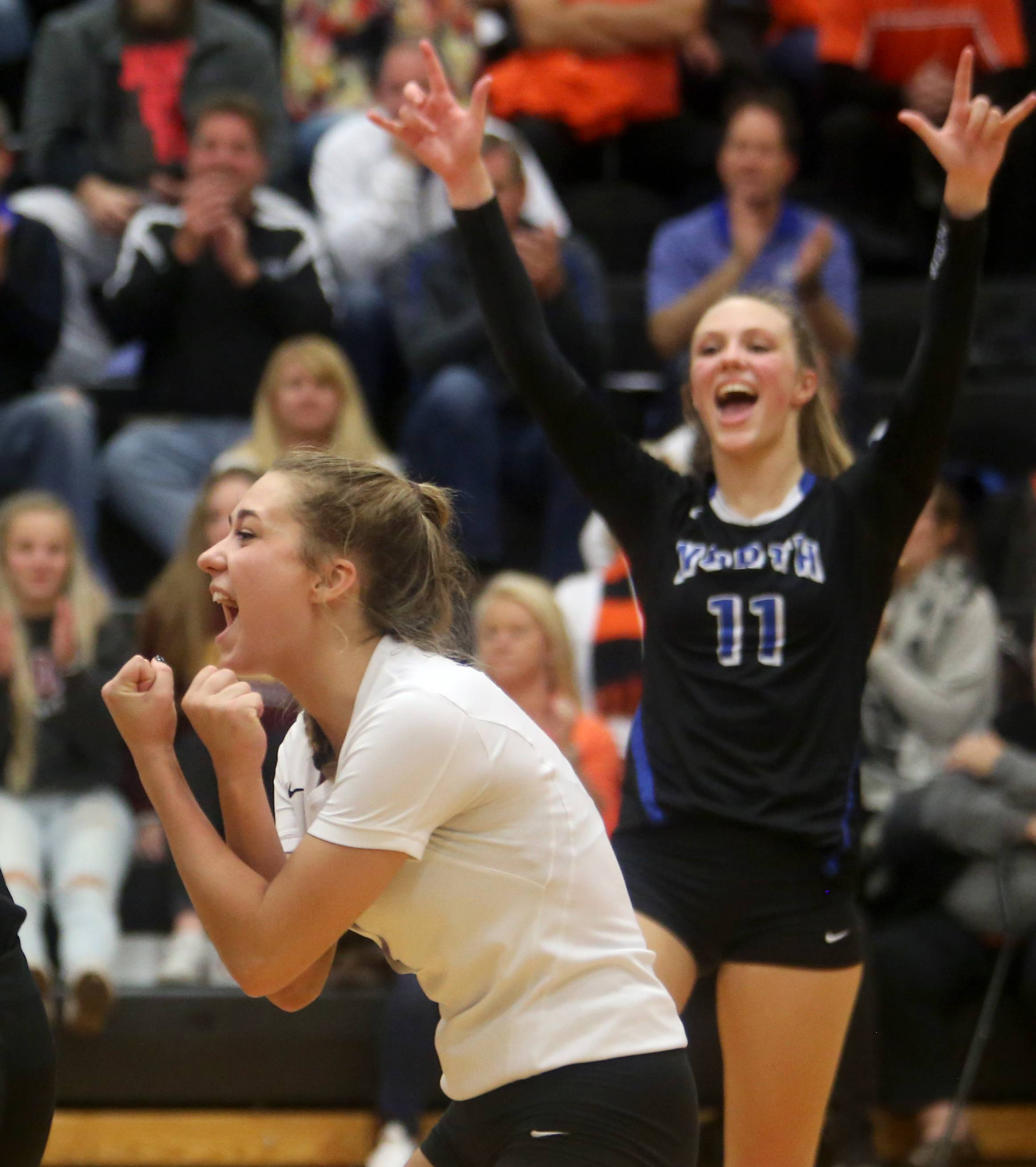 The St. Charles North Stars begin to celebrate a sectional title victory over St. Charles East at Chuck Dayton Gymnasium on the campus of DeKalb High School Wednesday night. Lauren Caprini, left, and Katie Lanz react to the win.