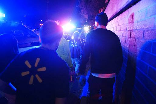 "Employees exit the parking lot after a gunman opened fire inside of Walmart in Thornton, Colo., Tuesday, Nov. 1, 2017. Thornton police tweeted Wednesday night that they were responding to a shooting with ""multiple parties down."" They advised people to stay away from the area as dozens of police cruisers and emergency vehicles raced to the scene. (AAron Ontiveroz/The Denver Post via AP)"