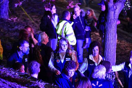 "Walmart employees gather together outside away from the scene of the Walmart store where a shooting occurred inside the store, Wednesday, Nov. 1, 2017, in Thornton, Colo. Thornton police tweeted Wednesday night that they were responding to a shooting with ""multiple parties down."" They advised people to stay away from the area as dozens of police cruisers and emergency vehicles raced to the scene. (Helen H. Richardson/The Denver Post via AP)"