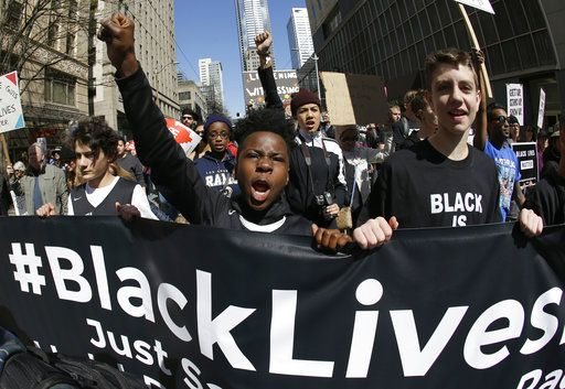 "FILE - In this April 15, 2017 file photo, young protesters take part in a Black Lives Matter march in Seattle. The awarding of the Sydney Peace Prize to Black Lives Matter for its work on American race issues is being hailed by local activists as a progressive step, but is also highlighting Australia's own struggles with race relations. The Sydney Peace Foundation will award its prize to Black Lives Matter for inspiring a ""bold movement for change at a time when peace is threatened by growing inequality and injustice.� Australian activists say such issues need to be addressed at home as well."