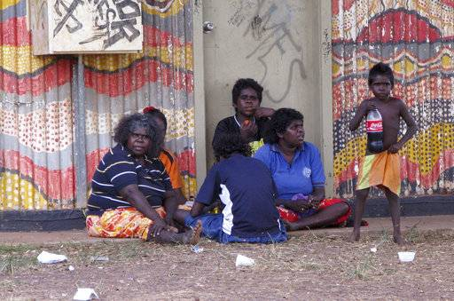 "FILE - In this May 29, 2009 file photo, locals sit on a street side in downtown Wadeye in the Northern Territory of Australia. The awarding of the Sydney Peace Prize to Black Lives Matter for its work on American race issues is being hailed by local activists as a progressive step, but is also highlighting Australia's own struggles with race relations. The Sydney Peace Foundation will award its prize to Black Lives Matter for inspiring a ""bold movement for change at a time when peace is threatened by growing inequality and injustice.� Australian activists say such issues need to be addressed at home as well."