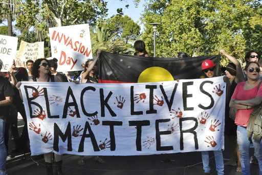 "FILE - In this Jan. 26, 2017 file photo Aboriginal activists carry a banner during an Australia Day protest in Adelaide, Australia. The awarding of the Sydney Peace Prize to Black Lives Matter for its work on American race issues is being hailed by local activists as a progressive step, but is also highlighting Australia's own struggles with race relations. The Sydney Peace Foundation will award its prize to Black Lives Matter for inspiring a ""bold movement for change at a time when peace is threatened by growing inequality and injustice.� Australian activists say such issues need to be addressed at home as well. (Tim Dornin/AAP Image via AP)"