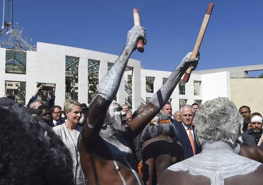 "FILE - In this Nov. 28, 2016 file photo, Australia's Prime Minister Malcolm Turnbull observes an aboriginal dance during an event against domestic violence outside Parliament House in Canberra. The awarding of the Sydney Peace Prize to Black Lives Matter for its work on American race issues is being hailed by local activists as a progressive step, but is also highlighting Australia's own struggles with race relations. The Sydney Peace Foundation will award its prize to Black Lives Matter for inspiring a ""bold movement for change at a time when peace is threatened by growing inequality and injustice.� Australian activists say such issues need to be addressed at home as well. (Lukas Coch/AAP Image via AP)"
