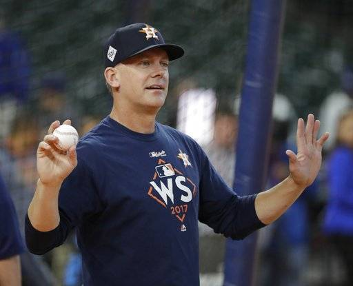 Houston Astros manager A.J. Hinch looks on during batting practice before Game 4 of baseball's World Series against the Los Angeles Dodgers Saturday, Oct. 28, 2017, in Houston.