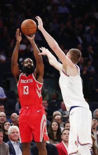 Houston Rockets' James Harden (13) shoots over New York Knicks' Kristaps Porzingis (6) during the first half of an NBA basketball game Wednesday, Nov. 1, 2017, in New York.