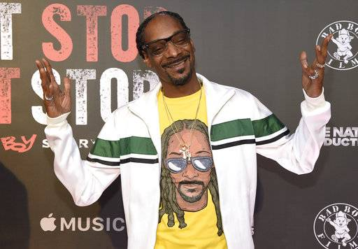 "FILE - In this Wednesday, June 21, 2017, file photo, Snoop Dogg arrives at the Los Angeles premiere of ""Can't Stop, Won't Stop: A Bad Boy Story"" at the Writers Guild Theater on in Beverly Hills, Calif. An album cover image posted to Snoop Dogg's Instagram account on Oct. 31, 2017, showing the rapper looking down on what appears to be the dead body of President Donald Trump has been removed from the platform. (Photo by Chris Pizzello/Invision/AP, File)"