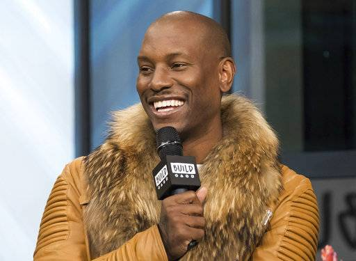 "FILE - In this April 6, 2017, file photo, Tyrese Gibson participates in the BUILD Speaker Series to discuss upcoming ""The Fate of the Furious"" film at AOL Studios in New York. Tyrese said on Instagram Nov. 1, 2017, he was doing OK hours after posting an emotional video to Facebook amid a court battle with his ex-wife. (Photo by Charles Sykes/Invision/AP, File)"