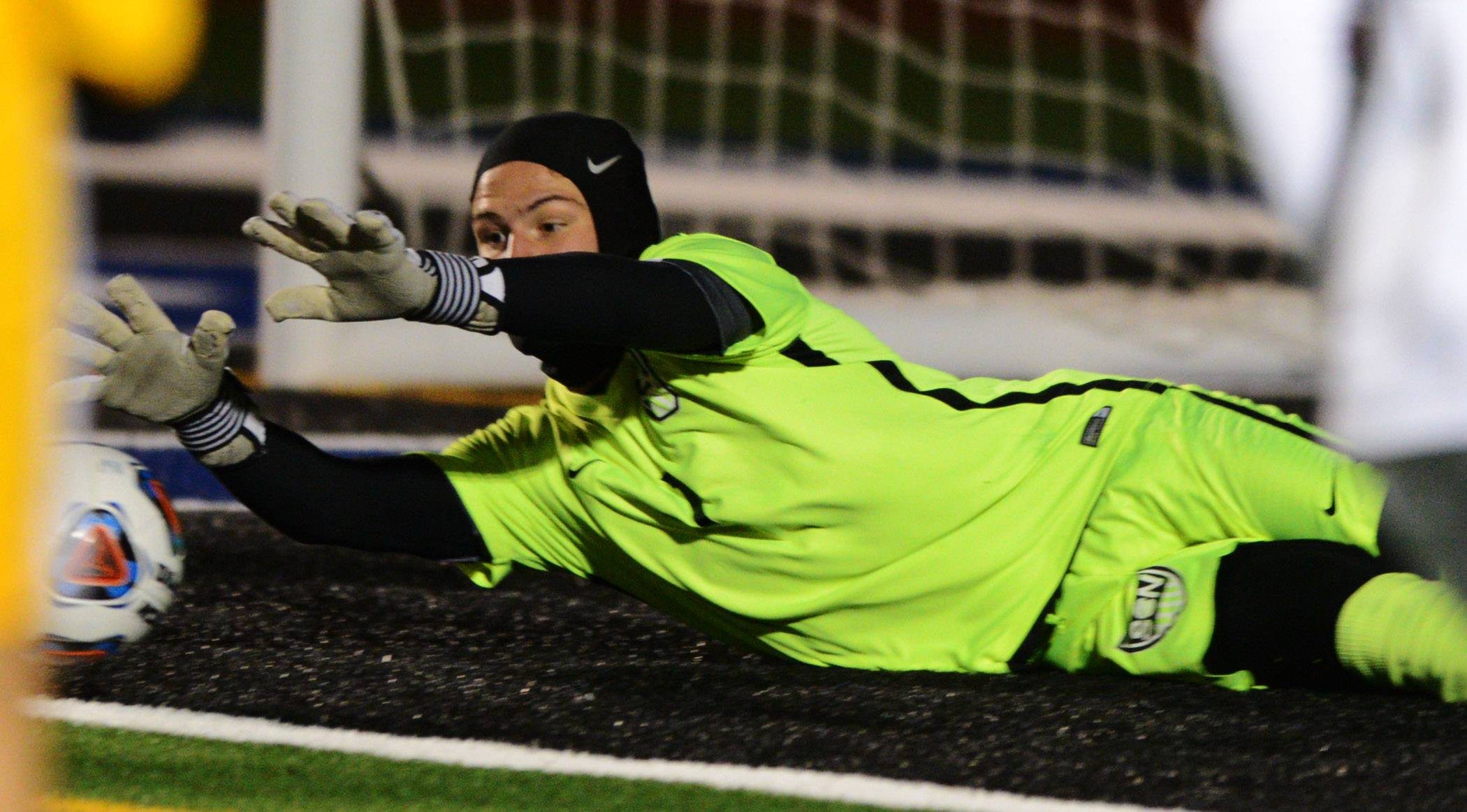St. Charles North goalkeeper Piercarlo Ricossa makes a diving save during the Class 3A boys soccer supersectional against Jacobs in St. Charles Tuesday. The North Stars will take on defending champion Naperville North Friday at 7 p.m. in a Class 3A state semifinal at Hoffman Estates High School.