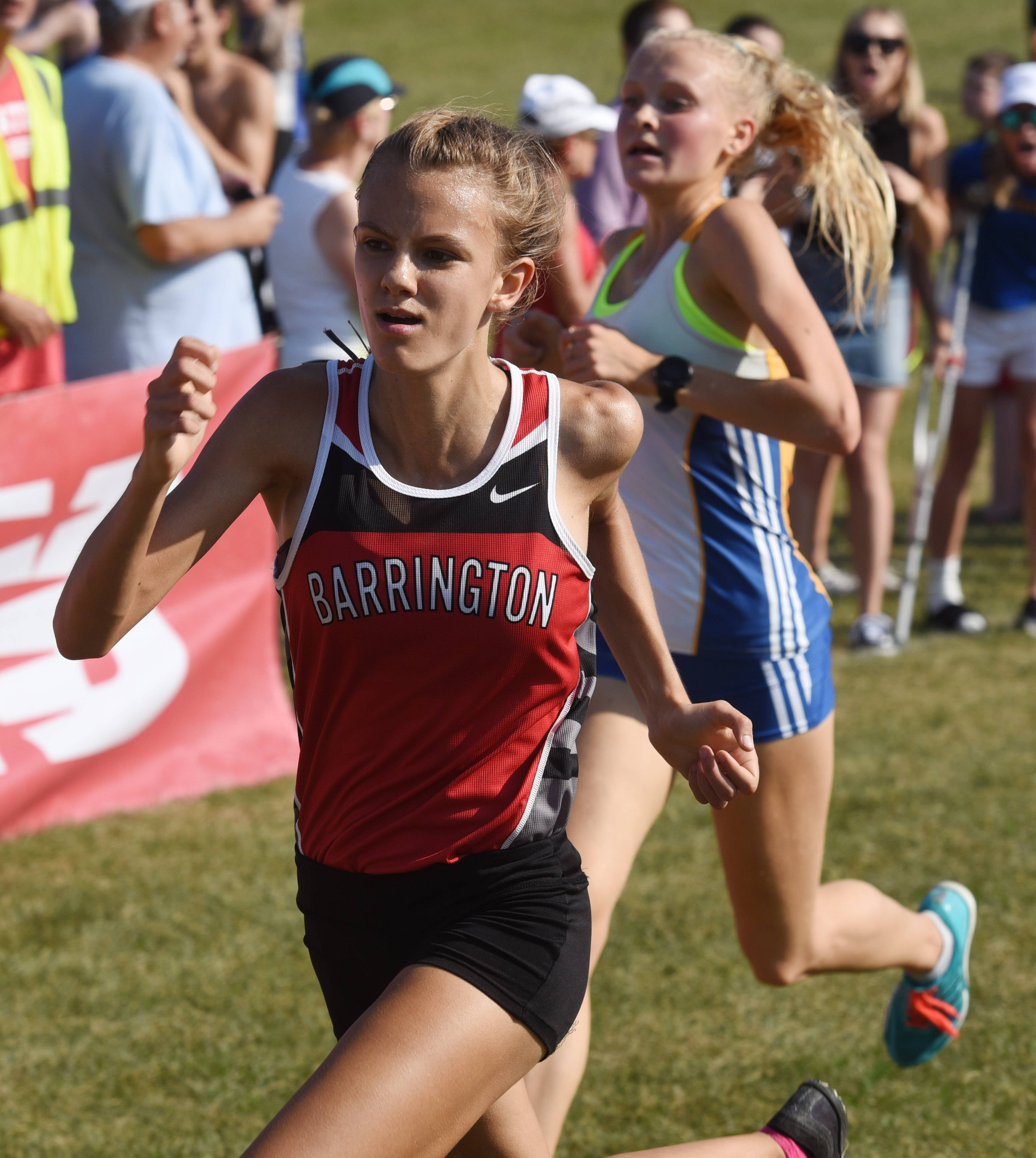 Barrington's Jocelyn Long edges out Lake Forest's Brett Chody for second place during the Palatine cross country invitational at Deer Grove Forest Preserve. The Fillies hope to be among the top teams in Saturday's Class 3A state meet.