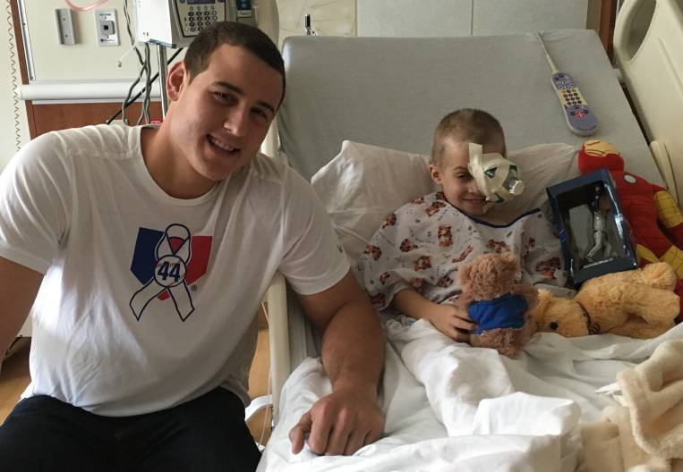 "Cubs first baseman Anthony Rizzo visits pediatric cancer patient Ethan Hugins, 6, at Lurie Children's Hospital. ""He thinks of him as his friend,"" said Ethan's mom, Ryanne Hugins. ""And he means the world to him."""